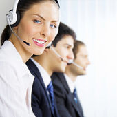 Three support phone operators at workplace — Stockfoto