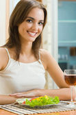 Cheerful woman with glass of redwine and salad  — Stock Photo