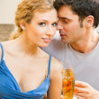 Cheerful couple with champagne — Stock Photo