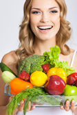 Young woman with vegetarian food, over gray — Stock Photo