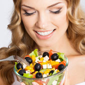 Woman with vegetarian salad, over gray — Stock Photo