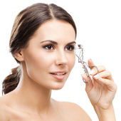 Woman with eyelash curler, isolated over white — Stock Photo