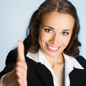Zakenvrouw hand geven voor handdruk, over blauw — Stockfoto