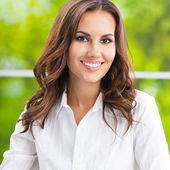 Young smiling businesswoman at office — Foto de Stock
