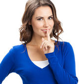 Woman keeping finger on her lips, isolated — Stock Photo