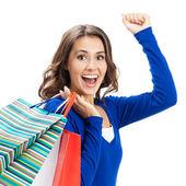 Giovane donna felice con borse della spesa, isolato — Foto Stock