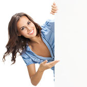 Beautiful young woman showing blank signboard — Stock Photo