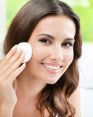Woman cleaning skin by cotton pad, at home — Stock Photo