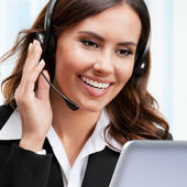 Support phone operator in headset, working with laptop — Stock Photo