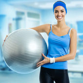 Woman with fitness ball, at gym — Stock Photo