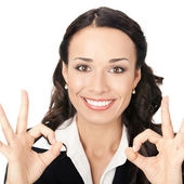 Businesswoman with okay gesture, on white — Stock Photo
