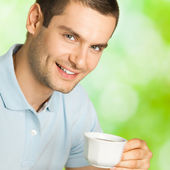 Man drinking coffee, outdoors — Stock Photo