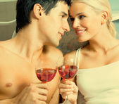 Couple with redwine at bedroom — Stock Photo