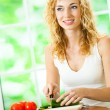 Young woman making vegetarian salad at home — Stock Photo #48029881