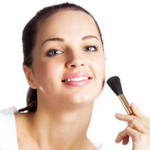 Woman with cosmetics brush, isolated — Stock Photo