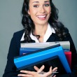 Businesswoman with folders, on gray — Stock Photo #48132773