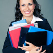 Businesswoman with folders, on gray — Stock Photo #48132857