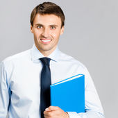 Portrait of business man with folder, over gray — Stock Photo