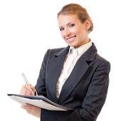Businesswoman writing, isolated on white — Stock Photo