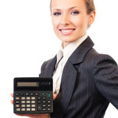 Businesswoman showing calculator, isolated on white — Stok fotoğraf