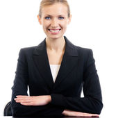 Smiling businesswoman at workplace, isolated — Stock Photo
