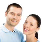 Portrait of young happy smiling attractive couple, isolated — Stock Photo