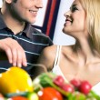 Young attractive happy smiling couple cooking at kitchen — Stock Photo #48811001