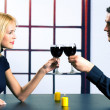 Young attractive happy smiling couple celebrating with red wine, — 图库照片 #48811787