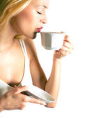 Young attractive blond woman drinking coffee, isolated on white  — Stock Photo