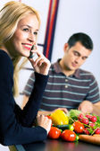 Young happy smiling attractive businesswoman and cooking man at  — Stock Photo