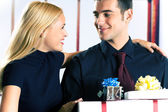 Young attractive happy smiling business people or couple with gi — Stock Photo