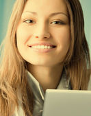 Cheerful female doctor with laptop — Stock Photo