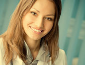 Cheerful female doctor at office — Stock Photo