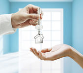 Key in hands — Stock Photo