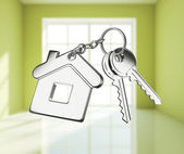 Key with keychain on white rooms — Stockfoto