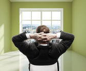 Man in green room — Stock Photo