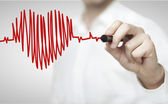 Drawing chart heartbeat — Stock Photo