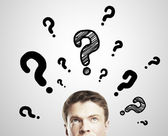 Man with questions — Stock Photo