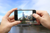Man photographs city — Stock Photo