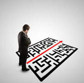 Businessman and labyrinth — Stock Photo