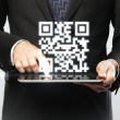 Stock Photo: Touchpad with qr code