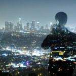 Businessman and night city — Stock Photo #14717387