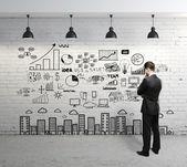 Bedrijfsconcept op muur — Stockfoto