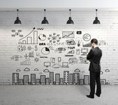 Business concept on wall — Stockfoto