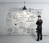 Businessman looking at business concept — Stock Photo