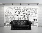 Big concept city and sofa — Stock Photo