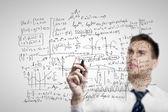 Человек рисования математических формул — Стоковое фото