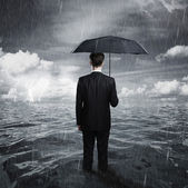 Man with umbrella — Stock Photo