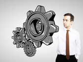 Businessman drawing gears — Stock Photo