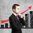 Man and growth chart on wall — Stock Photo #18676815